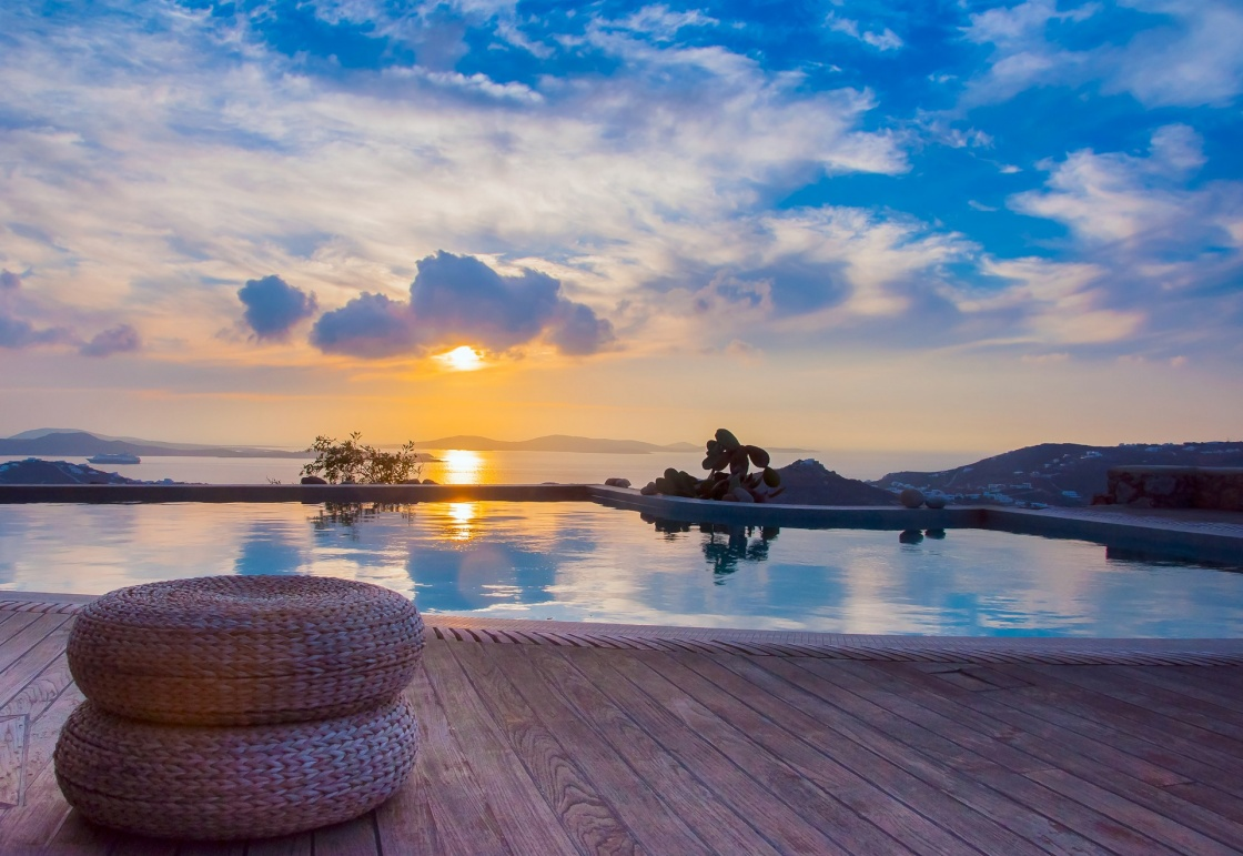 'The reflection of the beautiful clouds in the pool at sunset and the island ... Greece.' - Santorini