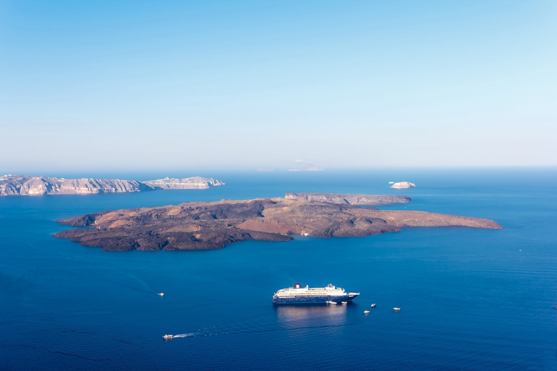 'Nea Kameni volcanic island in Santorini Greece with ships in front photographed from a high point of view' - Santorini